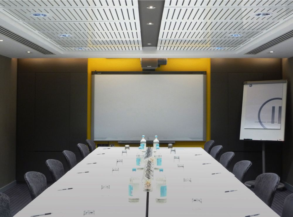 Perforated timber panel system for acoustic ceiling in London Hotel boardroom