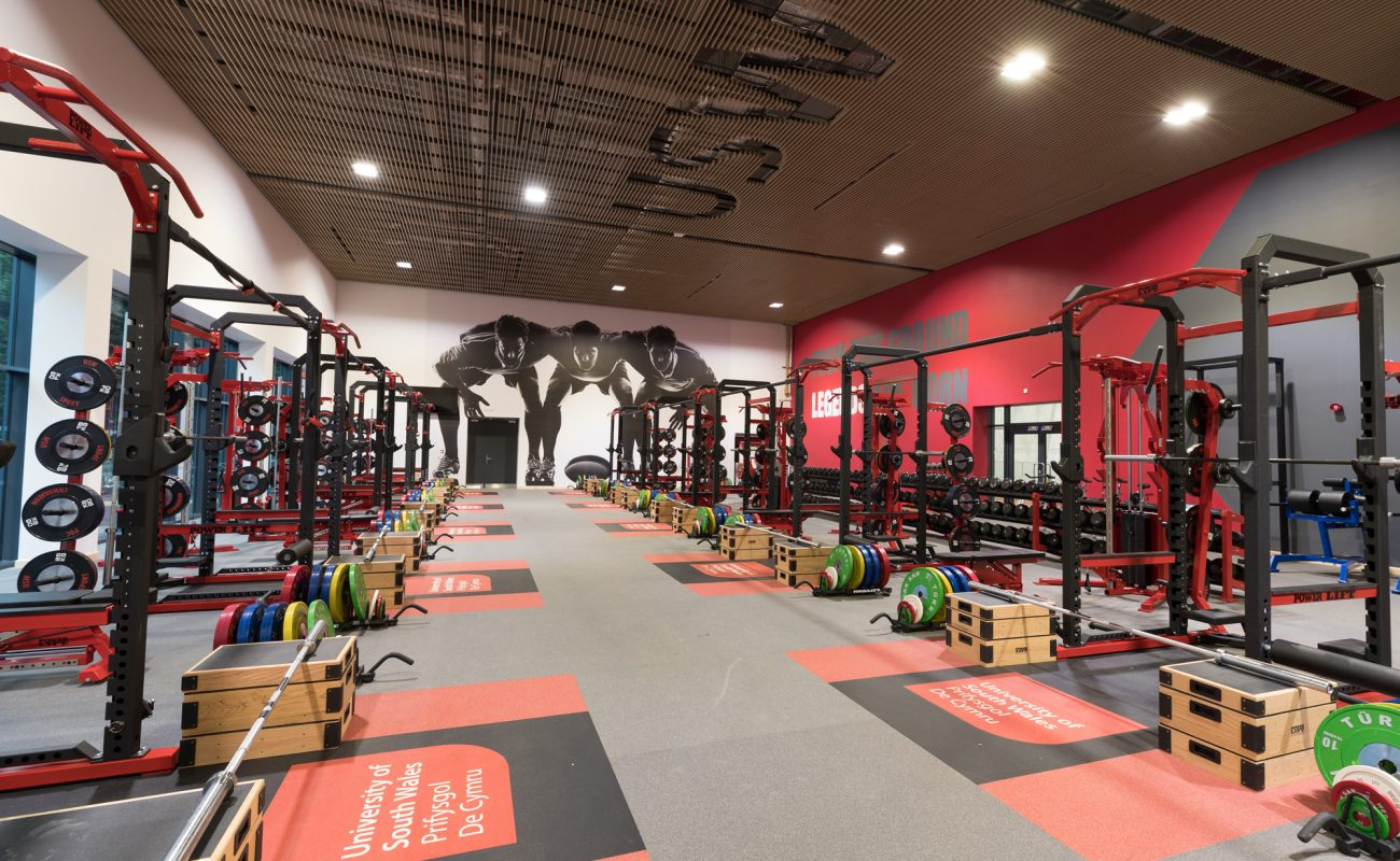 Bespoke acoustic timber slat ceiling in a gym, using Vtec's Supaslat 5